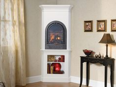 I think I'd like this gas one if it was at floor level -- Bella wood cabinet for the Crescent II arched fireplace by Heat N Glo Corner Gas Fireplace, Basement Fireplace, Wooden Fireplace, Fake Fireplace, Fireplace Wall, Living Room With Fireplace, New Living Room, Fireplace Design, Fireplace Mantels