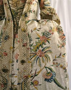 1740s Robe à la française, detail.  ~Front~ This painted silk gown is The Costume Institute's earliest example of the eighteenth- century fashion for exoticism and chinoiserie. @Metropolitan Museum of Art