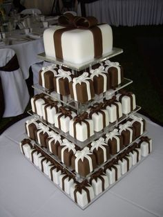 Square individual cakes decorated with chocolate sugarpaste bows