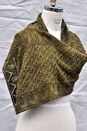 Inspired by the legend of Rhea Silvia, the mother of Romulus and Remus and a minor Roman deity of the forest, this luscious infinite wrap features burl-like cables and a lace leaf border in a drapy silk-wool blend. Wear it as a shawl, a scarf, cowl, or however you want!