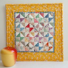 A cheery mini quilt for spring or summer decor.