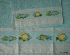 Asciugamani pesci colorati