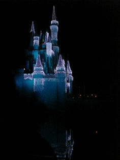 Dazzling holiday lights on Cinderella's Castle reflected in the moat — Orlando, Florida 2008