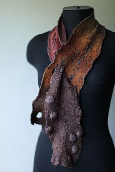 Beautiful scarflette. Like how the slot is used to secure it instead of a shawl pin. Nuno Felted Scarf Scarflett