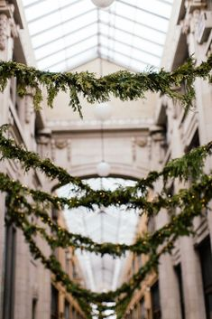 FOR THE RECEPTION || Hanging floral foliage garland & high glass ceilings || NOVELA BRIDE...where the modern romantics play & plan the most stylish weddings... www.novelabride.com (instagram: @novelabride) #novelabride #jointheclique
