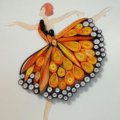 Paper Quilling - Reminds me of a Monarch Butterfly Dress at a shop in Downtown AshevilleArtist Deb Booth brings tiny dancers to life through quilled paper, evoking the grace of their movements., who discovered the art of quilling during a perusequill Paper Quilling Tutorial, Quilled Paper Art, Paper Quilling Designs, Quilling Paper Craft, Quilling Patterns, Paper Crafts, Paper Toys, Arte Quilling, Quilling Butterfly