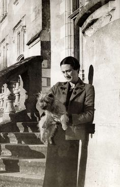 "Bessie Wallis Warfield Spencer-Simpson-Windsor (19 Jun 1896-24 Apr 1986) USA holding a dog in 1937 at Castle Candé, France by unknown photographer, published in Life, Spaarnestad Photo Studio. Wife of the Prince of Wales, Edward Albert Christian George Andrew David, later King Edward VIII ""David"" (23 Jun 1894-28 May 1972), later Duke of Windsor, UK."