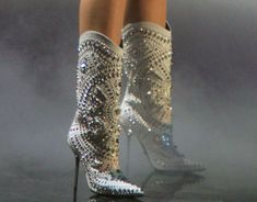 Miley Cyrus wearing studded white Versace boots for her performance