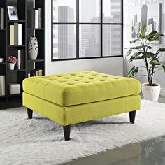 Empress Upholstered Large Ottoman, Wheatgrass - End the rule of unjust sovereignties that wage a useless war for your interiors. Empress leaves the would be heiress of holistic furnishings in the dust, with a design that rivals any competitor. Empress is heralded with deeply tufted buttons, plush cushions and armrests that convey that perfect air of nobility. The black stained solid wood legs come with plastic glides to prevent floor scratching, and the fine fabric upholstery leaves the…