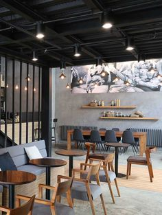 A second seating area in the first floor is under the #mezzanine, with tables and chairs for two, ideal for dates.