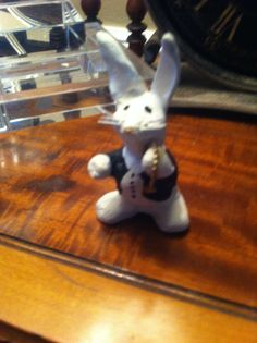 clay rabbit with pocket watch