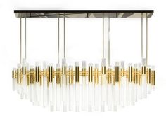 Everything sparkles under the elegant Waterfall Rectangular, a lighting piece that goes hand in hand with the luxurious spirit of Maison & Objet 2017 Paris trends! Elegant Chandeliers, Luxury Chandelier, Modern Chandelier, Modern Lighting Design, Custom Lighting, Modern Design, Luxury Lighting, Brass Lamp, Pendant Lamp
