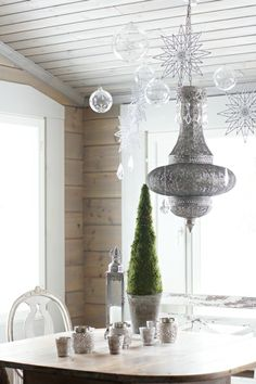 Winter decoration--hang from dining room light, clear ornaments and glitter snowflakes