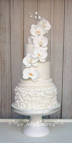 Orchid Ruffles Wedding Cake | An all white cake with a botto… | Flickr