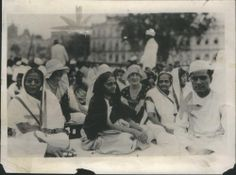 Mrs. Kasturba Gandhi wife of Mahatma Gandhi (Extreme right), visits with American women during a political meeting in Bombay, India - 1931