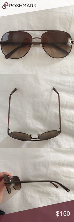 Tory Burch Aviators - never been worn! Tory Burch aviators in mint condition; bronze metal frames and brown tinted lenses; case not included Tory Burch Accessories Glasses