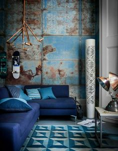 Rustic blue and orange color on walls giving a old vintage n industrial look with industrial lighting..