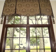 """Soft cornice / valance over transom window.  """"No Sew"""" cornice with tassel trim and large tassels on the corners.  Mounted fabric on a 1""""x 4"""" covered board."""