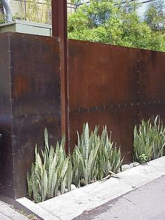 LOVE this: steel fence panels - we could repurpose some of the steel from the jail in the same way. Say on the west side as a privacy fence.
