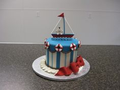 Baby shower cake for a women doing a nautical themed nursery.  Design based an many, many, many cakes I saw here.  Chocolate cake with cocnut peacan filling and vanilla BC.  All decorations are fondant.  Thanks for looking!