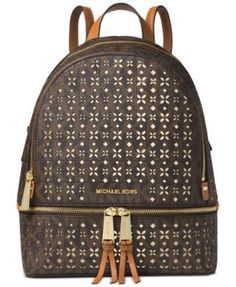 """Carry an eye-catching signature style with the Rhea backpack by Michael Michael Kors, featuring distinctive perforated details. 
