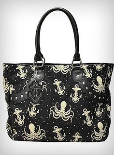 Out-to-Sea Octopus Tote Bag  Add some wicked deep-sea charm to your wardrobe with this large black canvas tote bag. It is covered in an ivory colored Octopus and Anchor print, and features black faux leather handles and scalloped trim, silvertone stud accents, and a cute little leatherette anchor print charm dangling from the handle. The interior has one large main compartment with a small zippered pocket on one side.