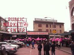 A pink umbrella mob at Pike Place Market