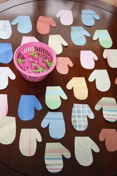 Mitten match up with clothespins - great fine motor activity. Up the skill challenge by having students hang mittens on a clothesline or create patterns with them.