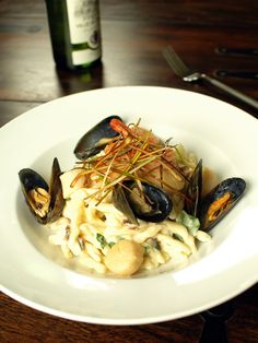 Butter & White Wine Poached Seafood on Pasta with Pancetta, Parsley & Crispy Leeks