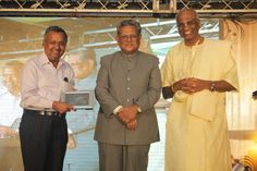 Ravindra Chamaria receiving a memento from Former Justice Rajendra Babu
