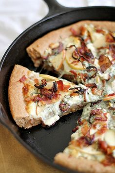 Talk about a fall pizza - Caramelized Apple, Bacon + Blue Cheese Pan Pizza via Girl Versus Dough.