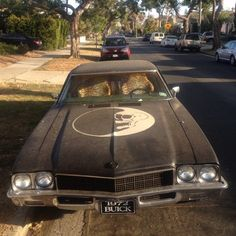 black skull crescent moon old car