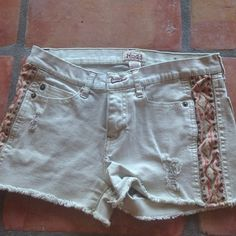 Shorts Beige shorts with tribal design on the sides. Really comfortable and gently worn! Unfortunately they are too small on me now. Mudd Shorts Jean Shorts