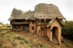 I love the collapsed roof on this one. Medieval Houses, Medieval Castle, Medieval Peasant, Fantasy Village, Farm Village, Tabletop, Portal, Thatched House, Farm Photo