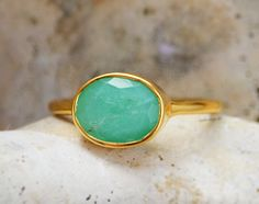 This beautiful stackable bezel set ring is made with oval faceted Chrysoprase gemstone in 18K Vermeil Gold. The ring has a 925 stamp. Gemstone