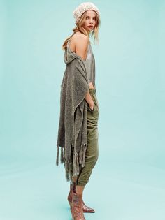 Light My Fire Shimmer Kimono | Shimmering hooded kimono made with metallic threads strewn throughout and an open, easy-to-drape-on silhouette. Features large twinkling tassels hanging along the trim.