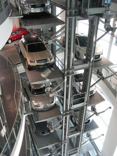 Garage Design:  Audi Museum - amazing storage solution.  I think I had a Hotwheels set that had a rack like this :-)