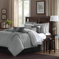 This soft and comfortable seven piece comforter set is ideal for giving your bedroom or guest room a stylish makeover. The black on grey accents give the set a contemporary feel and the three decorative pillows complete the look perfectly.