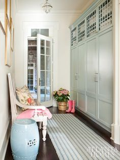 Designer Mallory Mathison Glenn's clients wanted a functional space that maintained a soft elegance mixed with unique, one-of-a-kind moments. To that end, she outfitted the mudroom with custom lockers, painted with Benjamin Moore's Beach Glass, to store everything from sports equipment to work bags.
