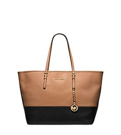Tap into one of the season's biggest trends with the Jet Set Travel tote, updated in a bold color-block design. We dreamt up this stylish, streamlined piece as the ultimate carryall. It works as a chic bag at the office, but is perfect for weekend trips, too. On your arm or over the shoulder, it's destined to become your go-to.