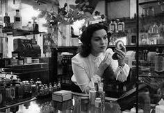 Joan a sales assistant at selfridge's department store oxford street london makes up at the perfume counter original publication picture post 4240 a girl finds a job to suit her pub 1946