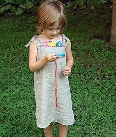 Oliver + S Popover Sundress pattern and tutorial- Size 2-8.  A FAST and easy summer sun dress that looks adorable.  The girls love these and they get worn often!