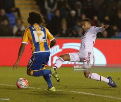 Jesse Lingard of Manchester United in action with Junior Brown of Shrewsbury Town during the Emirates FA Cup Fifth Round match between Shrewsbury Town and Manchester United at Greenhous Meadow on February 22, 2016 in Shrewsbury, England.