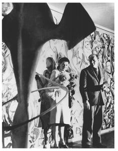 Peggy Guggenheim and Jackson Pollock in front of Pollock's Mural (1943) in the first-floor entrance hall of Guggenheim's residence in New York, photographed by George Karger, ca. 1946