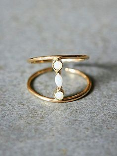 Adelaide Ring | 14k gold and opal ring, featuring fluted, beveled opal stones connecting two delicate adjustable bands.  *By Katie Diamond