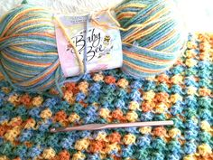 "This little blanket will go to a local pregnancy help center via the stitching guild at our church.  The yarn is an acrylic/polyamide blend and it is so soft.  The stitch is a shell stitch called ""bushy stitch"", which is made by doing a single crochet and two double crochets in the single crochet of the previous row.  Best thing I love about this yarn is the name ""Peas and Carrots""."