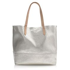 "Roomy and easy in metallic leather, you're going to want to carry this tote everywhere (it proves your work bag, errands bag, gym bag and going-out bag can all be the same bag). <ul><li>9"" handle drop.</li><li>13 1/2""H x 13 1/2""W x 6 1/4""D.</li><li>Leather.</li><li>Import.</li></ul>"
