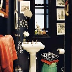 Navy bathroom, Orange Towels, Celadon Garden stool....