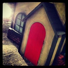 SG Studios creating an interactive stage set, titled: Christmas cottage, home for the holidays. Final last-minute touches finishing up painting techniques to bring out the character of this beautiful set.