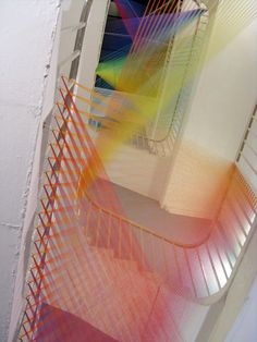 Dallas-based artist Gabriel Dawe (previously here and here) creates colorful site-specific installations using bright gradients of suspended thread.